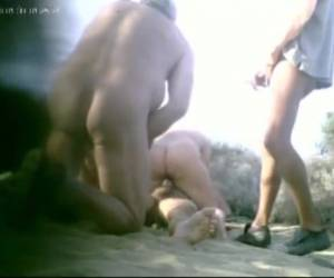 while there are several men getting fucked on the beach, they are secretly movie